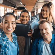 Four Young People Taking a Selfie on a Private Bus Charter