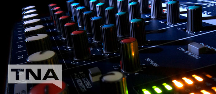Close up of an electronic music DJ sound board