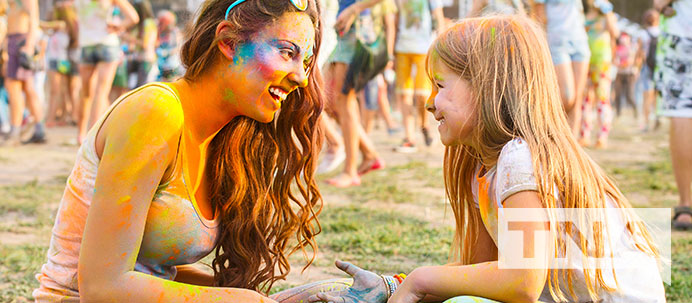 Mother and daughter covered in colour at a festival