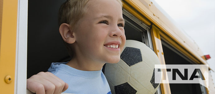 Happy Boy Riding the Bus with A Soccer Ball