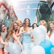 Hens Party in front of a hire party bus