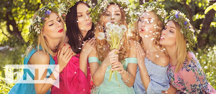 Hens party in flower crowns blowing dandelions