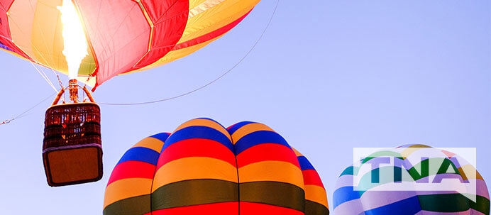 Three hot air balloons floating into the sky