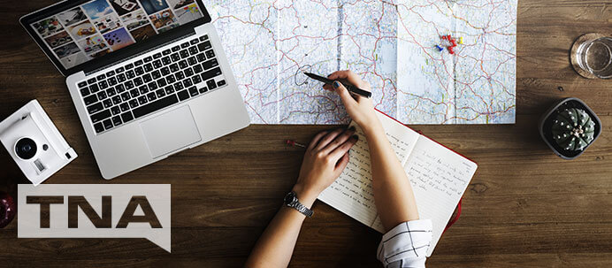 woman planning a holiday by bus with maps and laptop