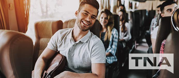 Smiling Male Charter Bus Passenger