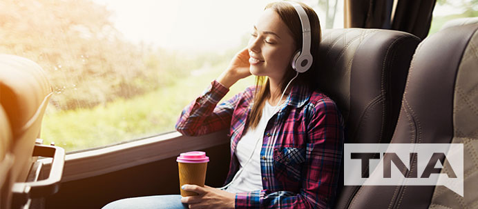 Woman listening to music on a private charter bus