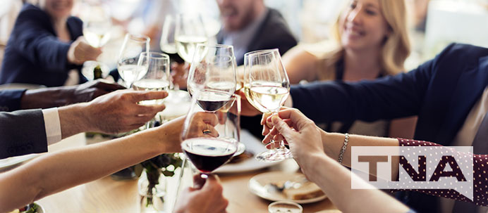 business people cheering with wine at a restaurant